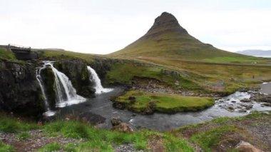 Kirkjufellsfoss and Kirkjufell in northern Iceland. Static shot.