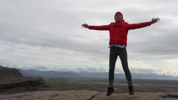 Young sportive woman makes morning yoga , Iceland