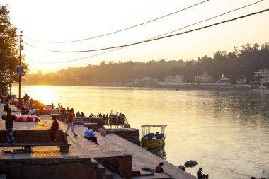 Rishikesh, Uttarakhand - December 1, 2019:  People waiting for the evening pudge ceremony to Shiva and river Ganga