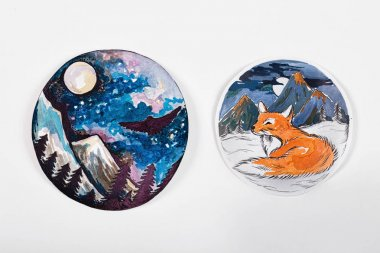 Sketch nightscape and foxes on a white background.