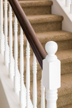Abstract of Stair Railing and Carpeted Steps in House