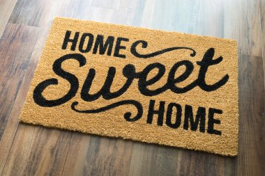 Home Sweet Home Welcome Mat On Wood Floor. stock vector