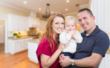 Young Military Family Inside Their Beautiful Kitchen