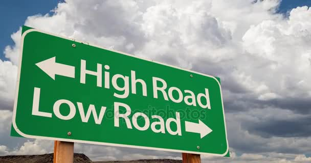 4K Time-lapse High Road, Low Road Green Road Sign and Stormy Cumulus Clouds and Rain.
