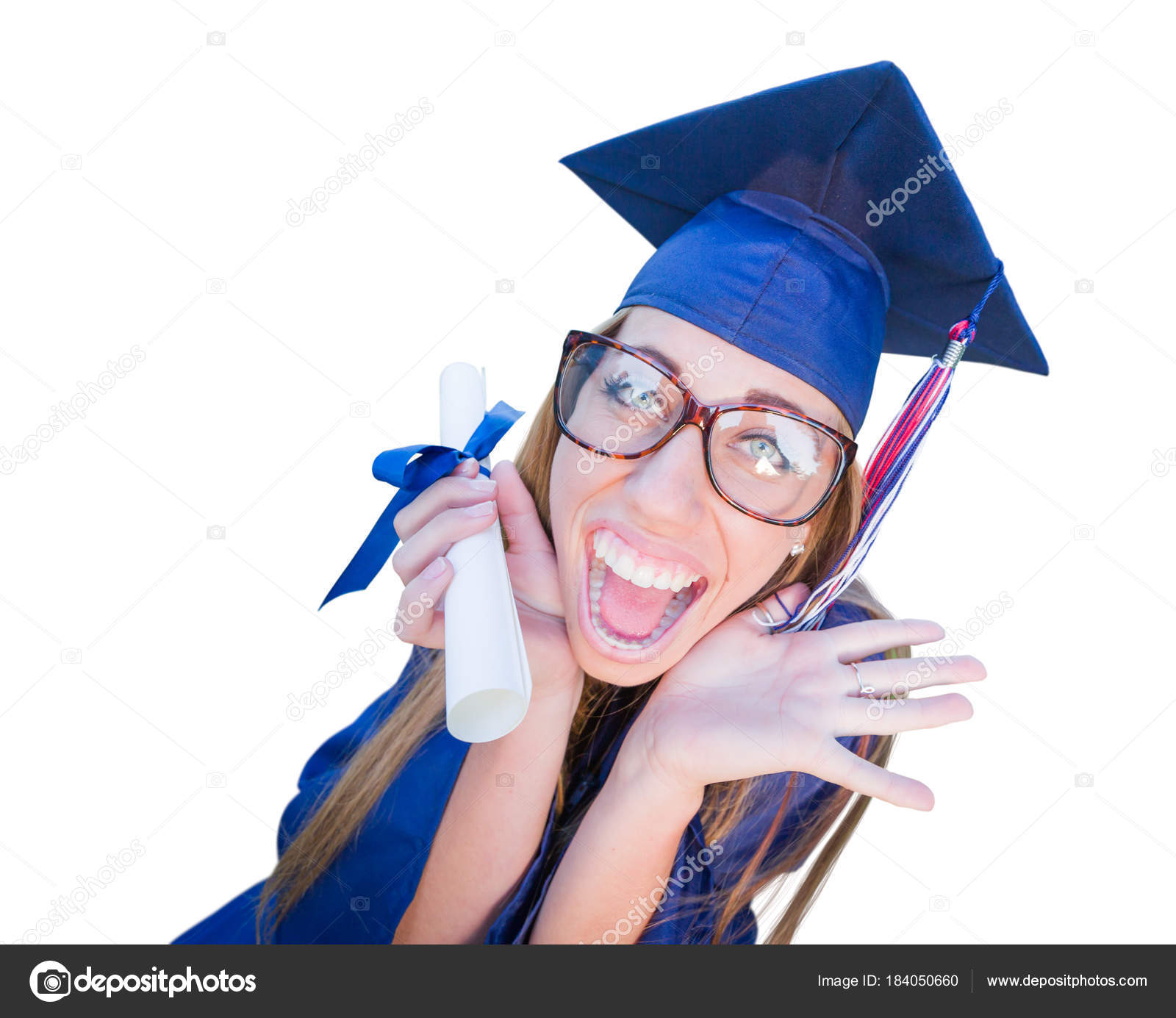 Goofy Graduating Young Girl In Cap and Gown Isolated on a White Background.  — Stock Photo © Feverpitch #184050660