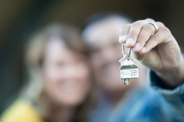 Mixed Race Couple Holding New House Keys