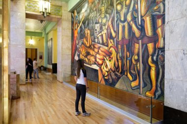 Visitors admiring the famous mural paintings at the museum of Pa