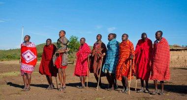 Unidentified Maasai men on Oct 15, 2012 in the Maasai Mara, Kenya. Maasai are a Nilotic ethnic group of semi-nomadic people located in Kenya and northern Tanzania. stock vector