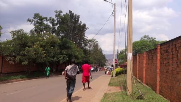 Unidentified people not far from the Ziniya Market in Kigali, Rwanda, in March 2019