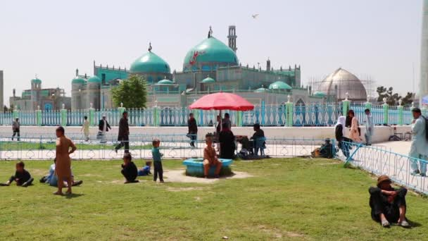 Unidentified Afghan people at the Blue Mosque in Mazar-i-Sharif, North Afghanistan, in 2018