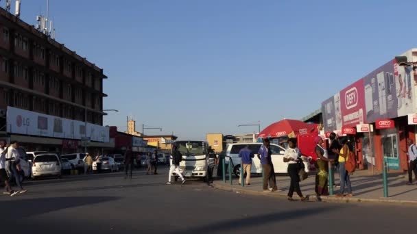 Street traffic and unidentified people in Lusaka, the capital of Zambia, Southern Africa, 2020