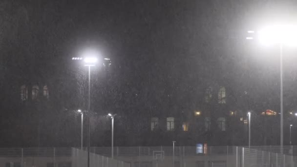 snow falling at night shot in slow motion. winter season bad weather storm
