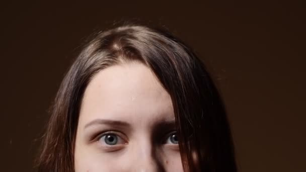 Portrait of a teen girl with a curious suspicious face. Closeup part of a face.