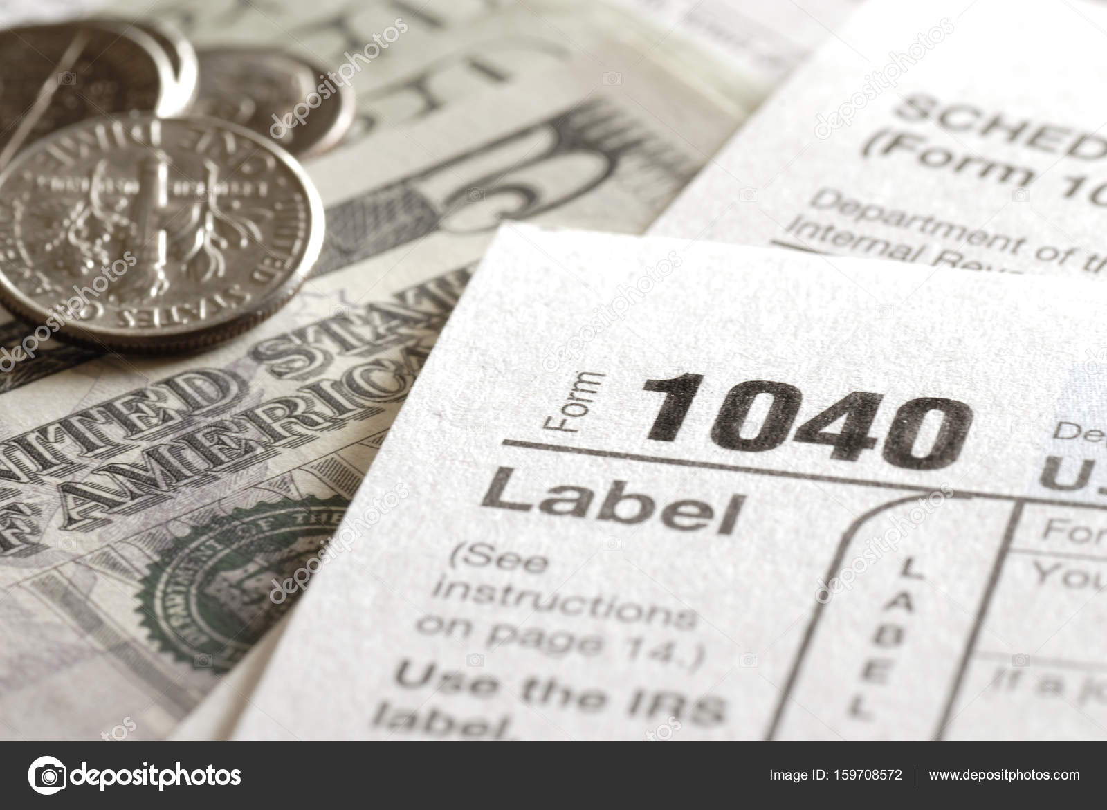 Tax forms 1040 for irs stock photo eric1513 159708572 tax forms for the irs income 1040 form photo by eric1513 falaconquin
