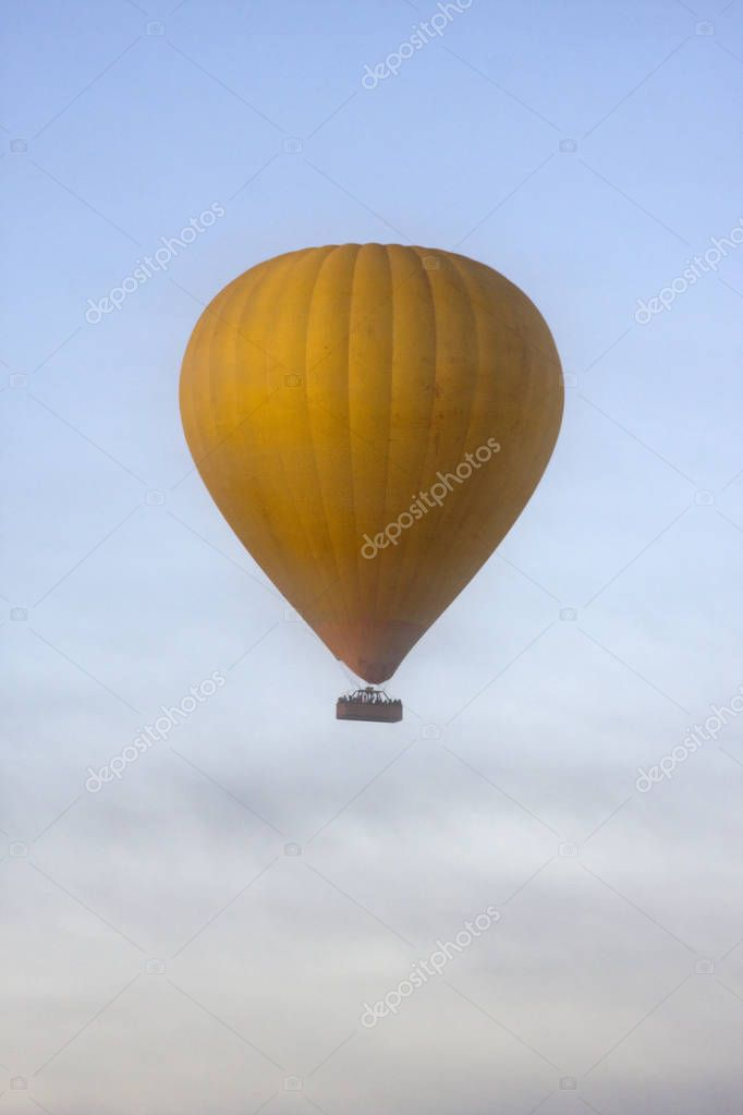 Yellow Hot Air Balloon in the Clouds