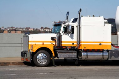 Eighteen Wheeler Cargo Trucked Waiting on Street