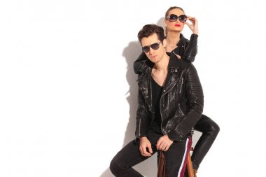 woman in leather jacket leaning her elbow on her man