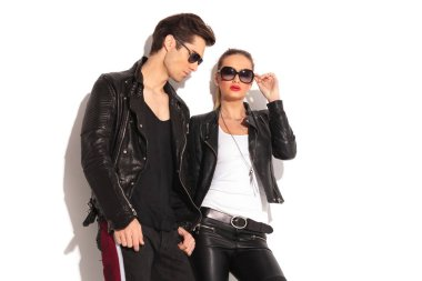 man standing near his girlfriend wearing leather jacket