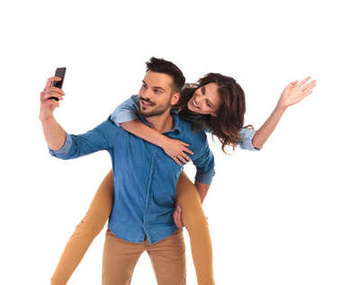 Woman on the back of man waving at the camera while he takes a selfie with his phone on white background stock vector