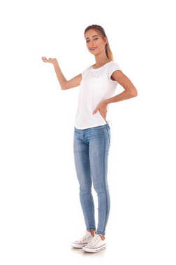 full body picture of a young casual woman presenting