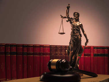 justice statue , law books and wooden gavel