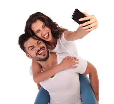 happy couple having fun with their selfies