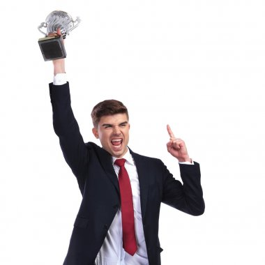 champion businessman holding trophy and pointing finger up