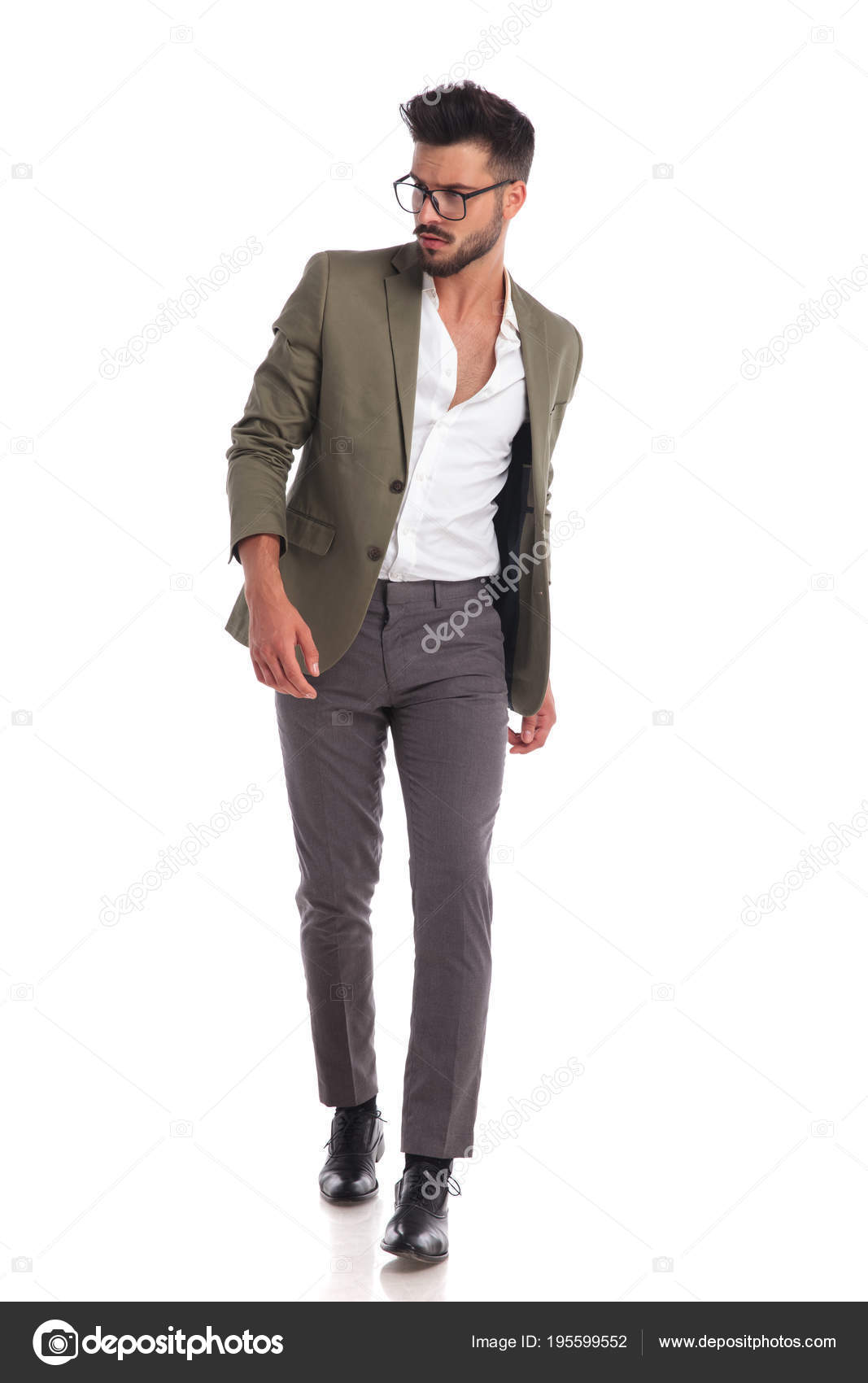 669c6ef21d4c Confident young man with glasses walking on white background and looking to  side while wearing a elegant green suit jacket — Photo by ...