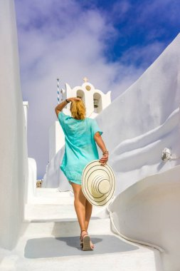 Young woman on holidays, Santorini Oia town