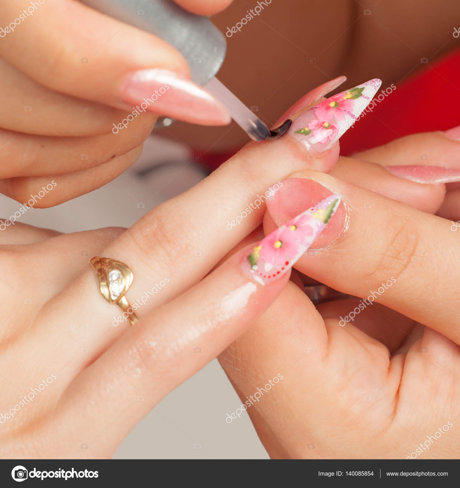 Manicure Process In Beauty Salon Showing Drawing And Polishing Of Artificial Fingernails Stock Photo
