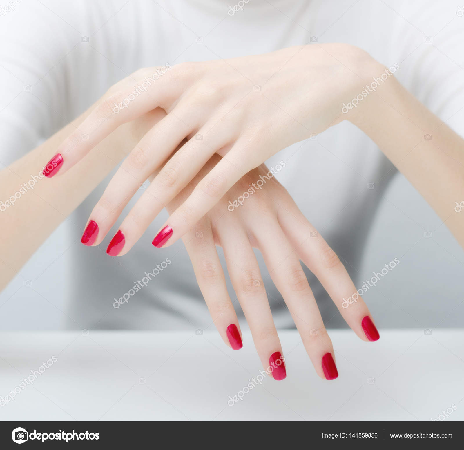 Beautiful elegant pale hands and long gracious fingers with ...