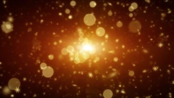 Sněhové vločky se světlem a částicemi. Abstraktní zlaté pozadí