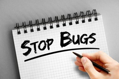 Text note - Stop Bugs, health concept on notepad