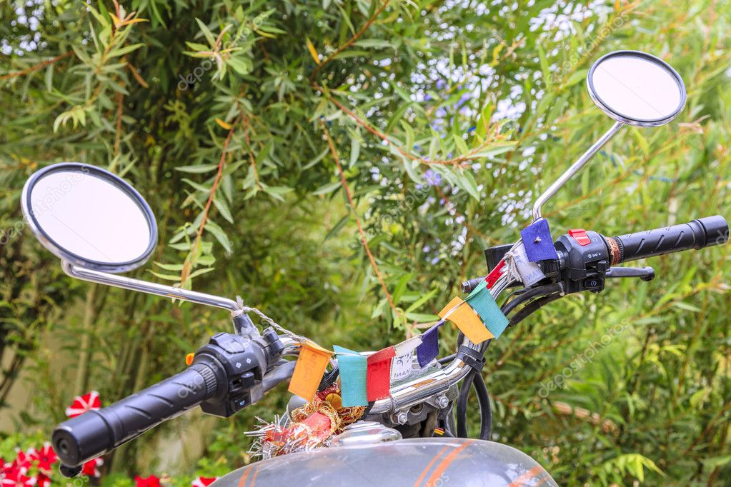 motorcycle with buddhist flags