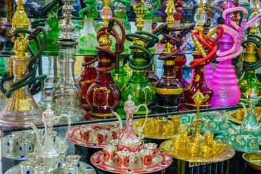 Hookahs on glass shelf in store