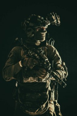 Portrait of elite commando fighter in darkness