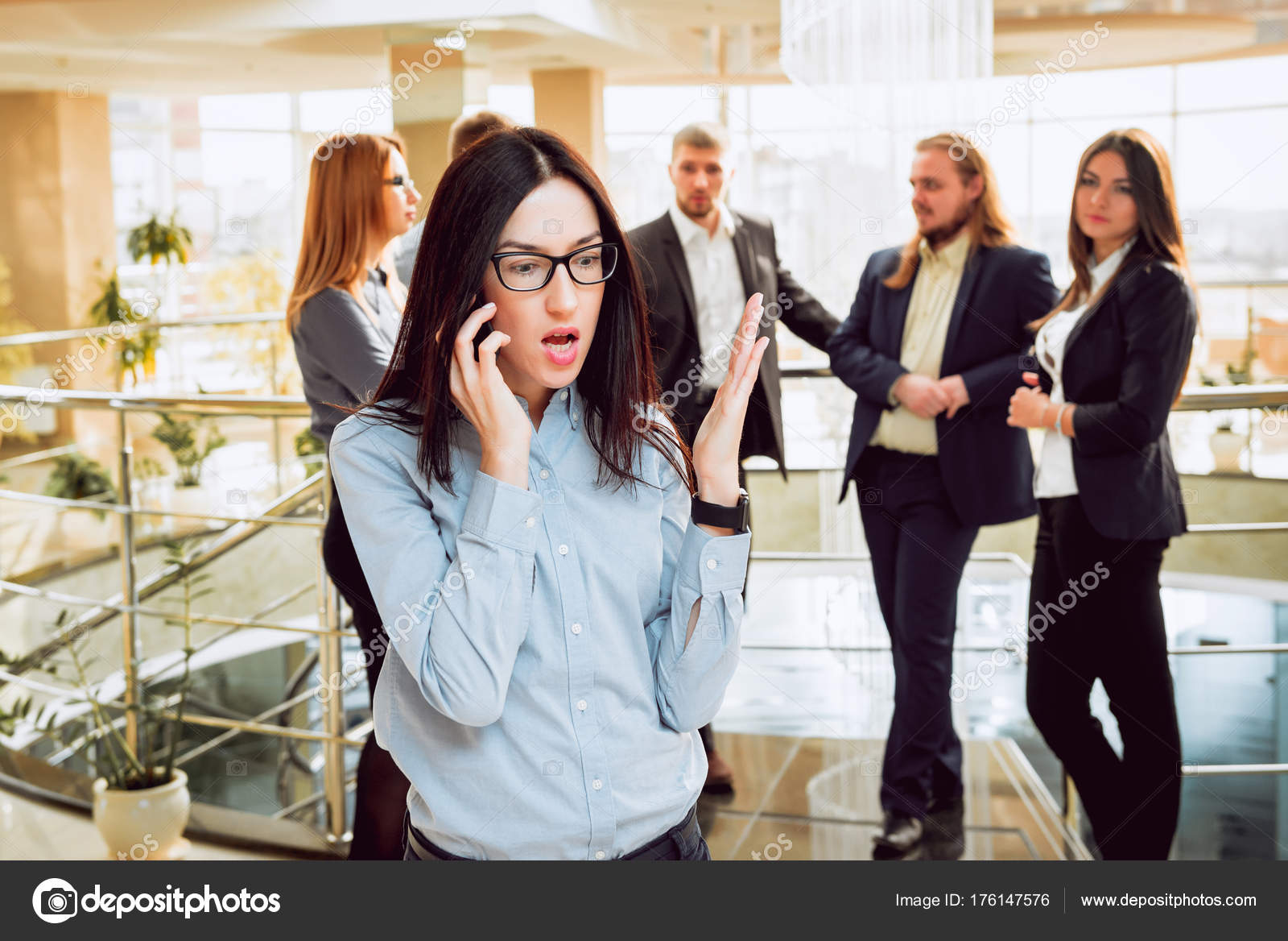 business woman talking phone meeting colleagues office routine
