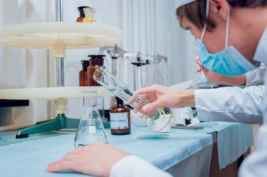 Science technician at work in the laboratory. Medical background