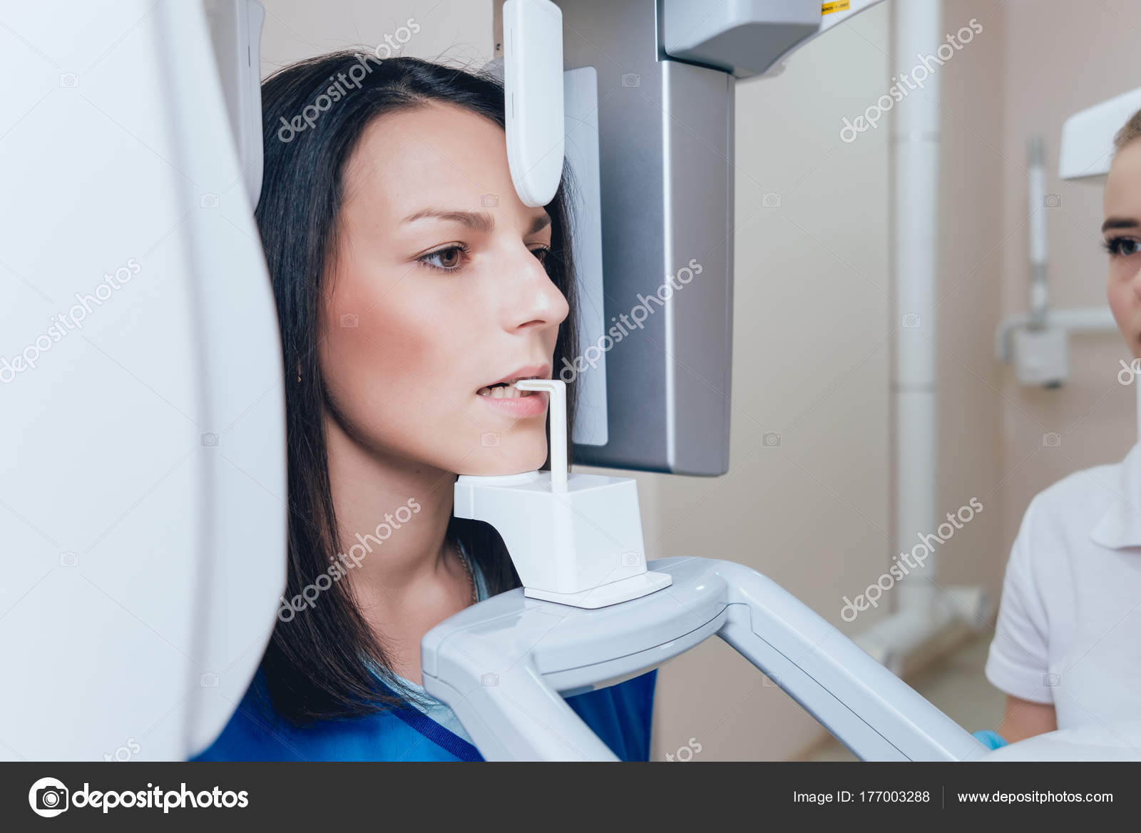Young Woman Patient Standing Ray Machine Panoramic