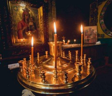 Church interior. Candles light.