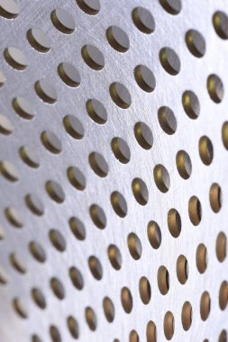 Aluminum metal sheet perforated with holes texture