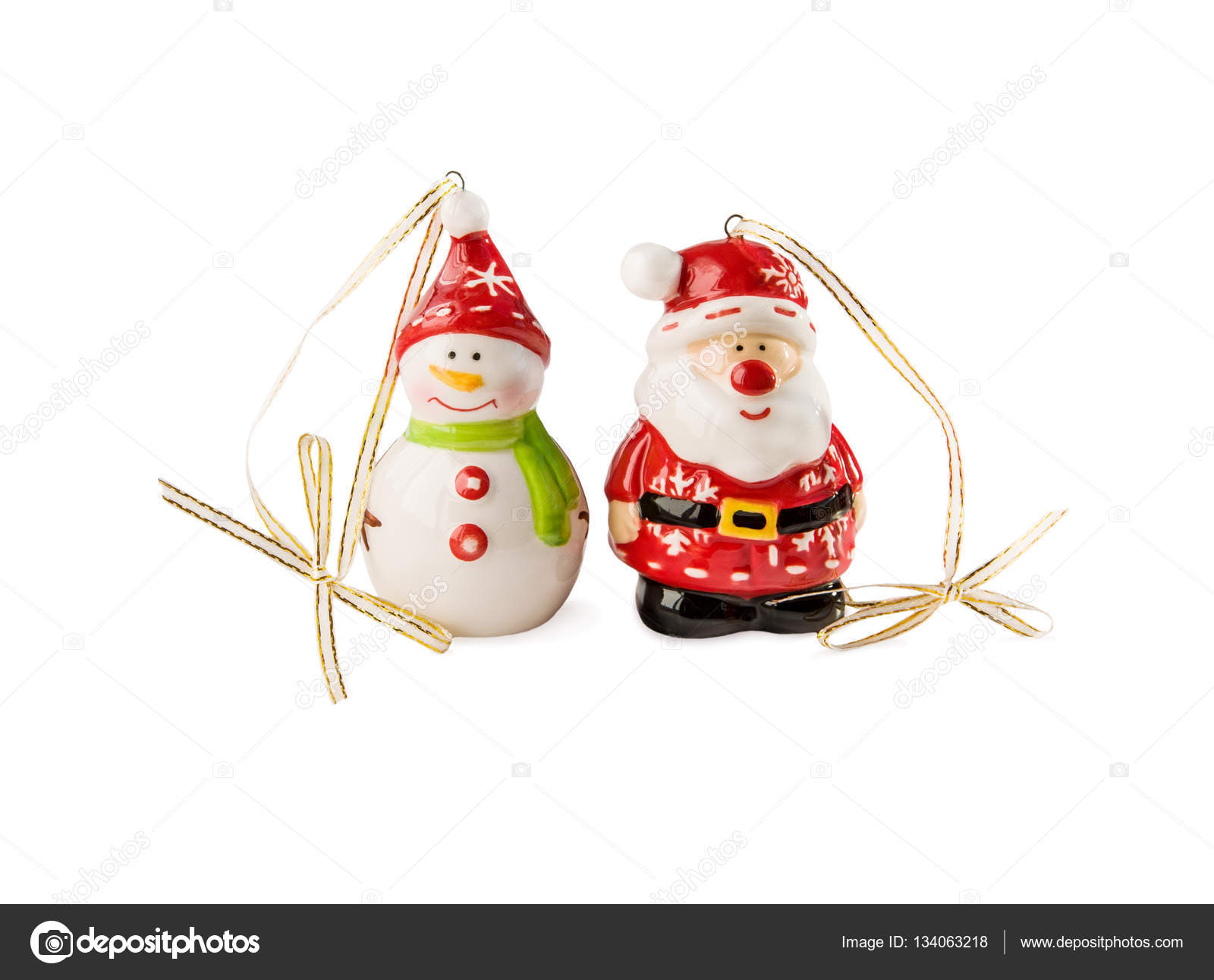 Christmas and New Year's decorations. Funny Snowman and Santa Claus toys made of porcelain isolated over white. — Photo by luckylia
