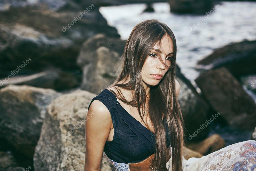 Young beautiful woman at the seaside