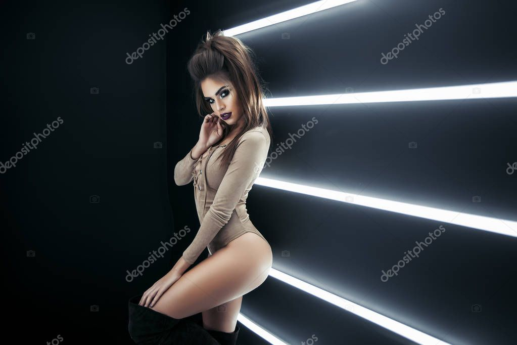 Gorgeous woman in flickering fluorescent lights