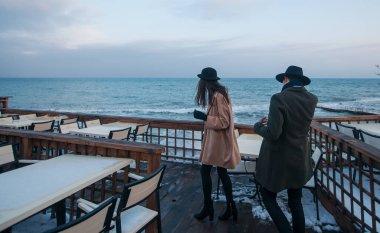 romance couple standing on sea terrace