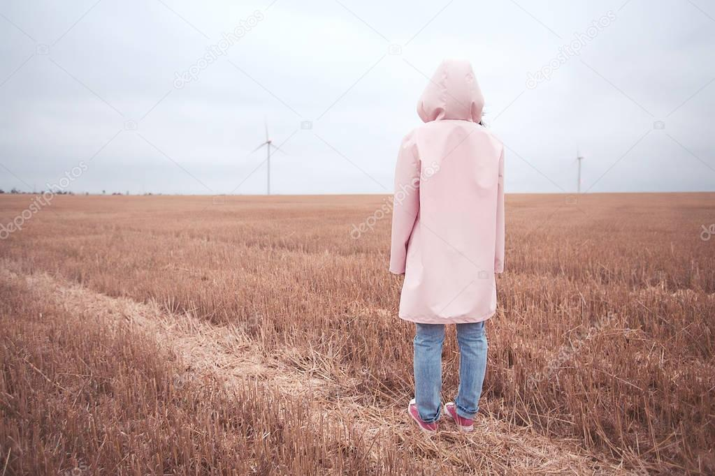 girl in pink raincoat with hood