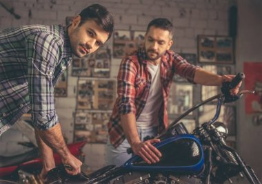 Guys at the motorbike repair shop