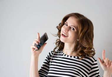 girl in headphones listening to music