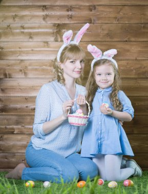 Mother and daughter  with Easter eggs