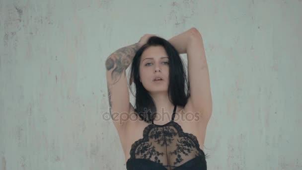 beautiful girl posing in studio in black lingerie